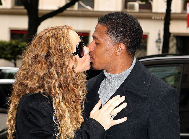 Mariah Carey and Nick Cannon share a kiss in Paris [USA ONLY]