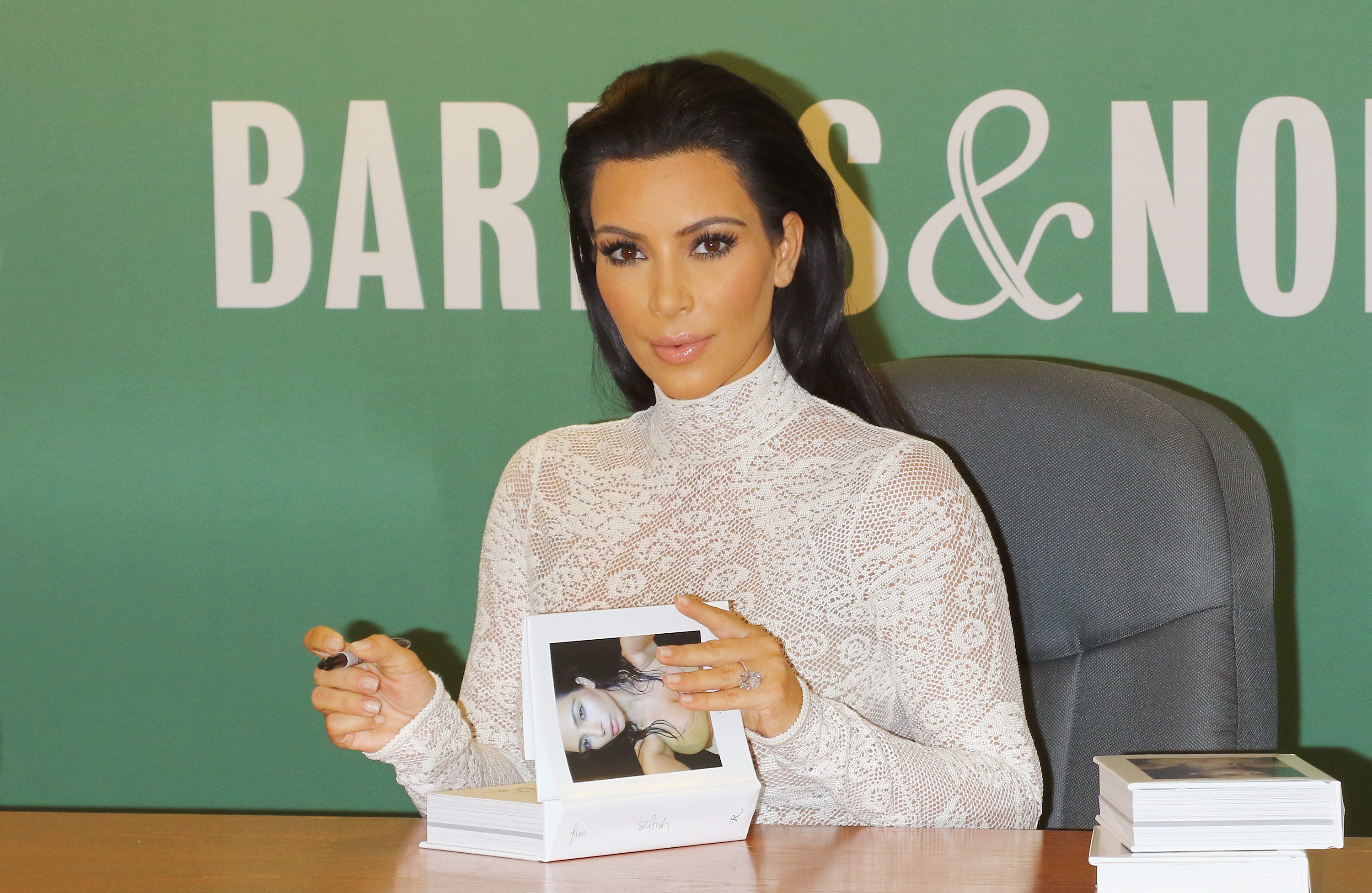 Kim Kardashian Signs Copies Of 'Selfish'