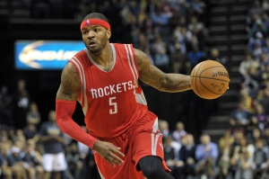 Houston Rockets forward Josh Smith (5) plays in the first half of an NBA basketball game Friday, Dec. 26, 2014, in Memphis, Tenn. (AP Photo/Brandon Dill)