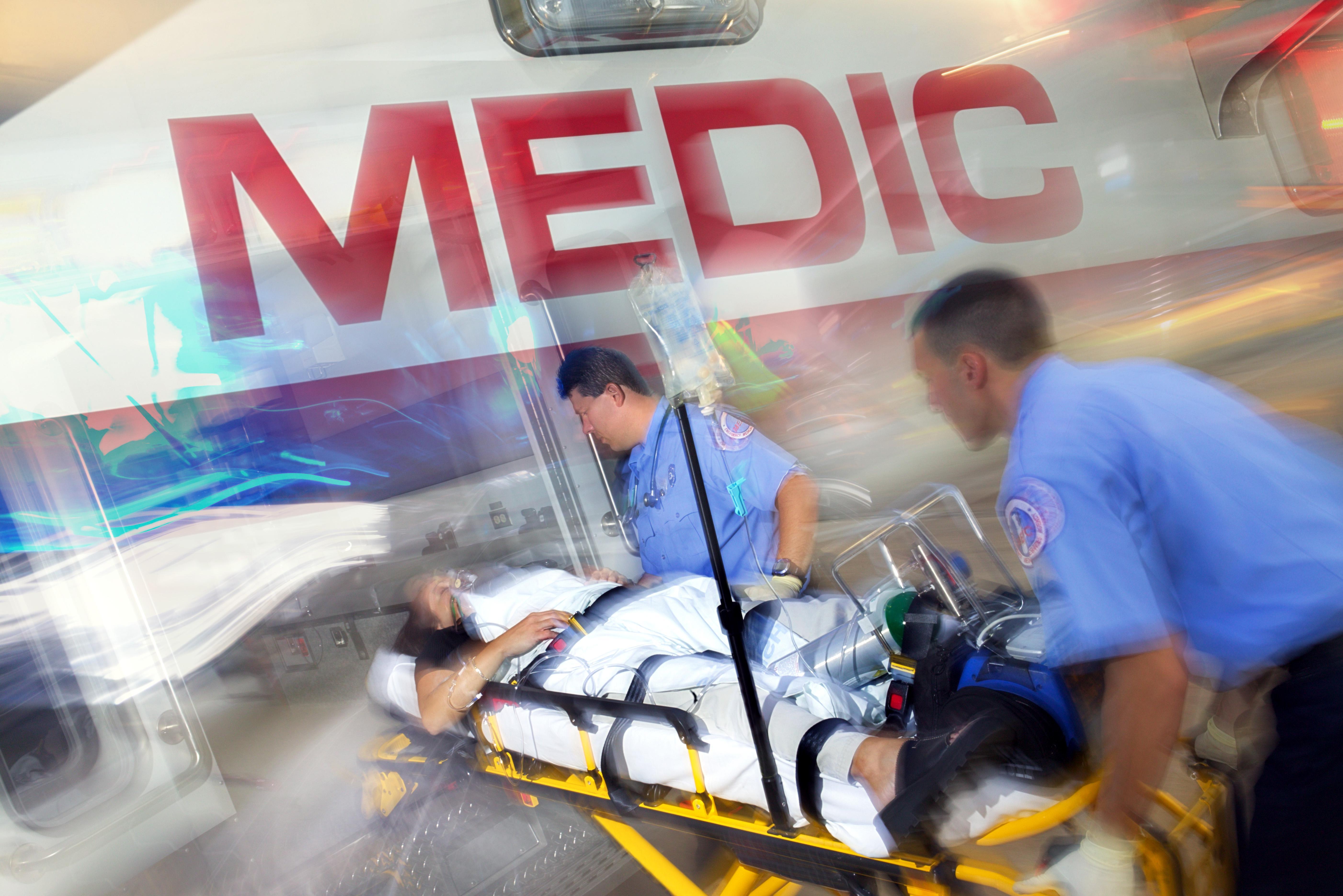 Paramedics loading patient into ambulance