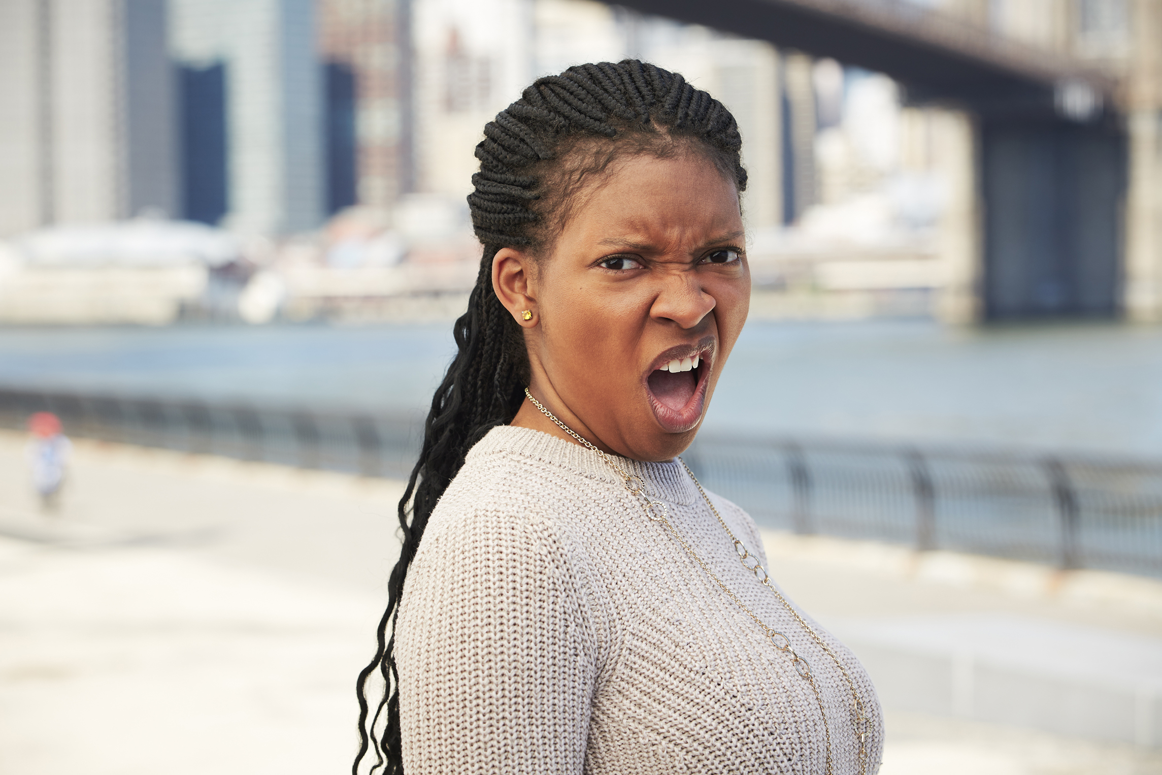 Black woman with disgusted attitude at waterfront