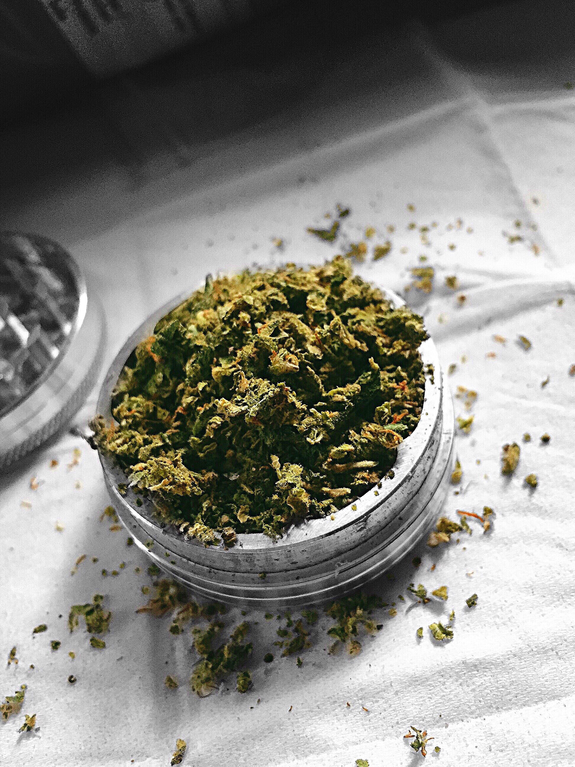 High Angle View Of Marijuana In Container On Table