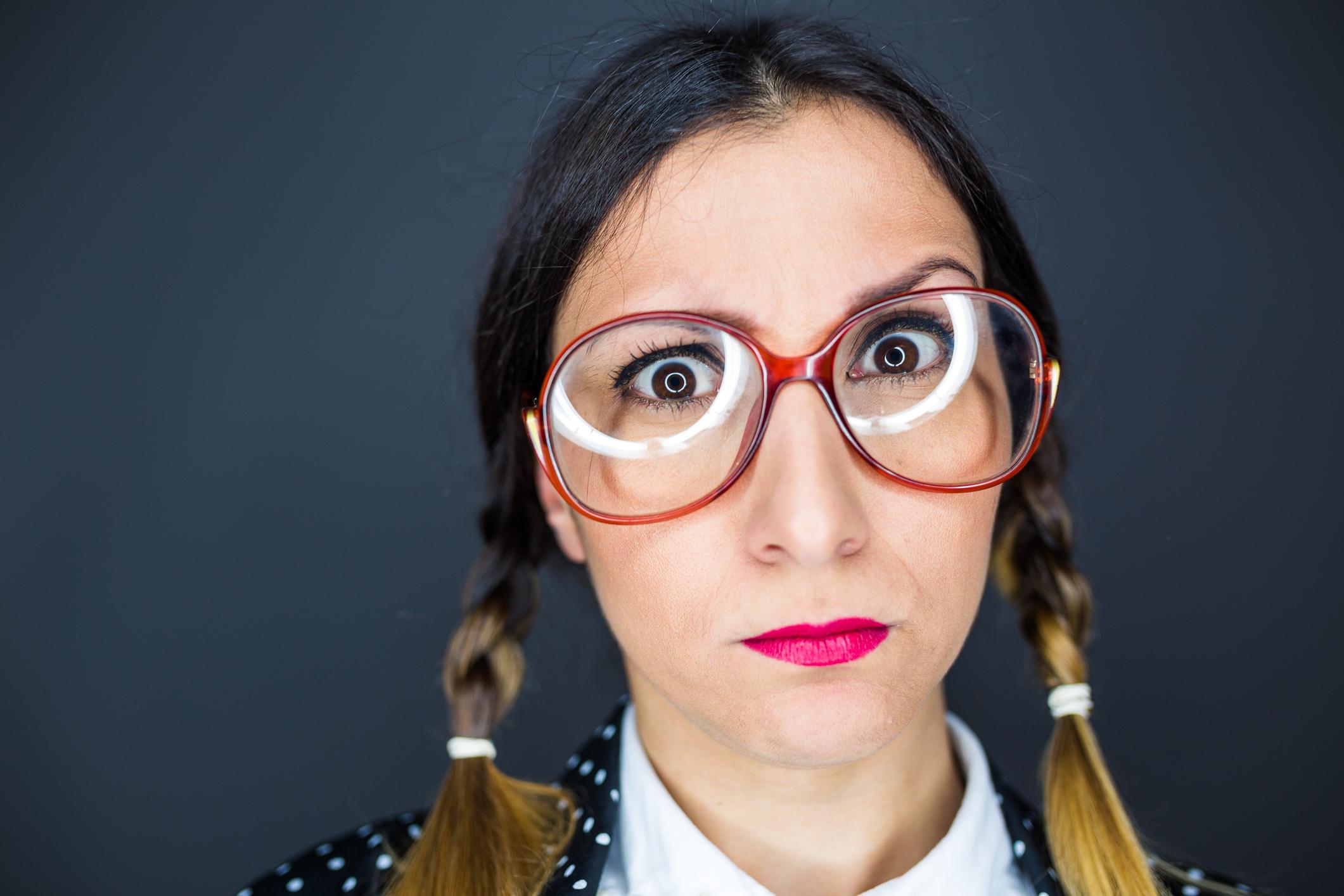 Funny nerd woman grimacing