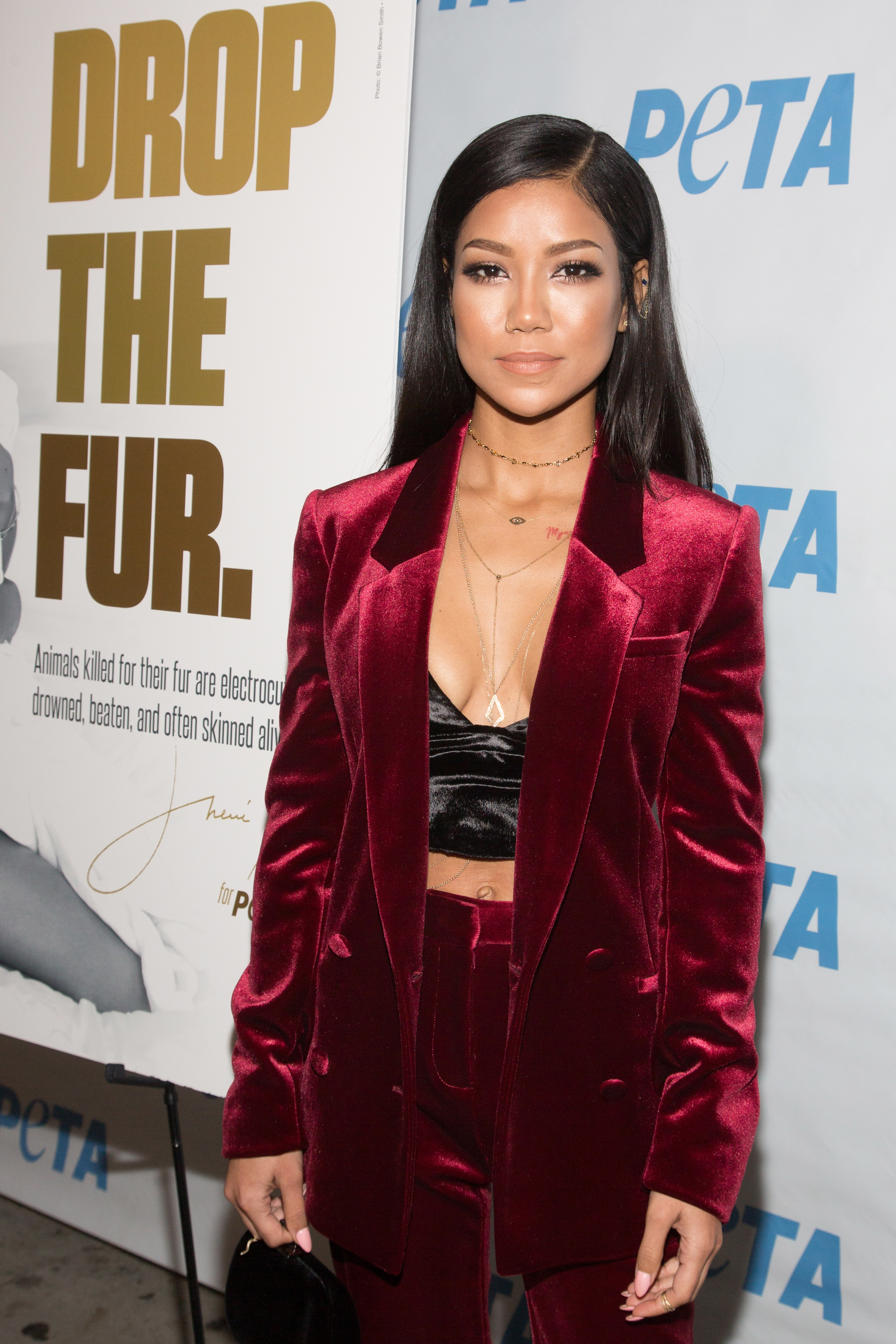 Jhene Aiko Unveils 'Rather Go Naked Than Wear Fur' Opening Night Of PETA's 'Naked Ambition' Exhibit