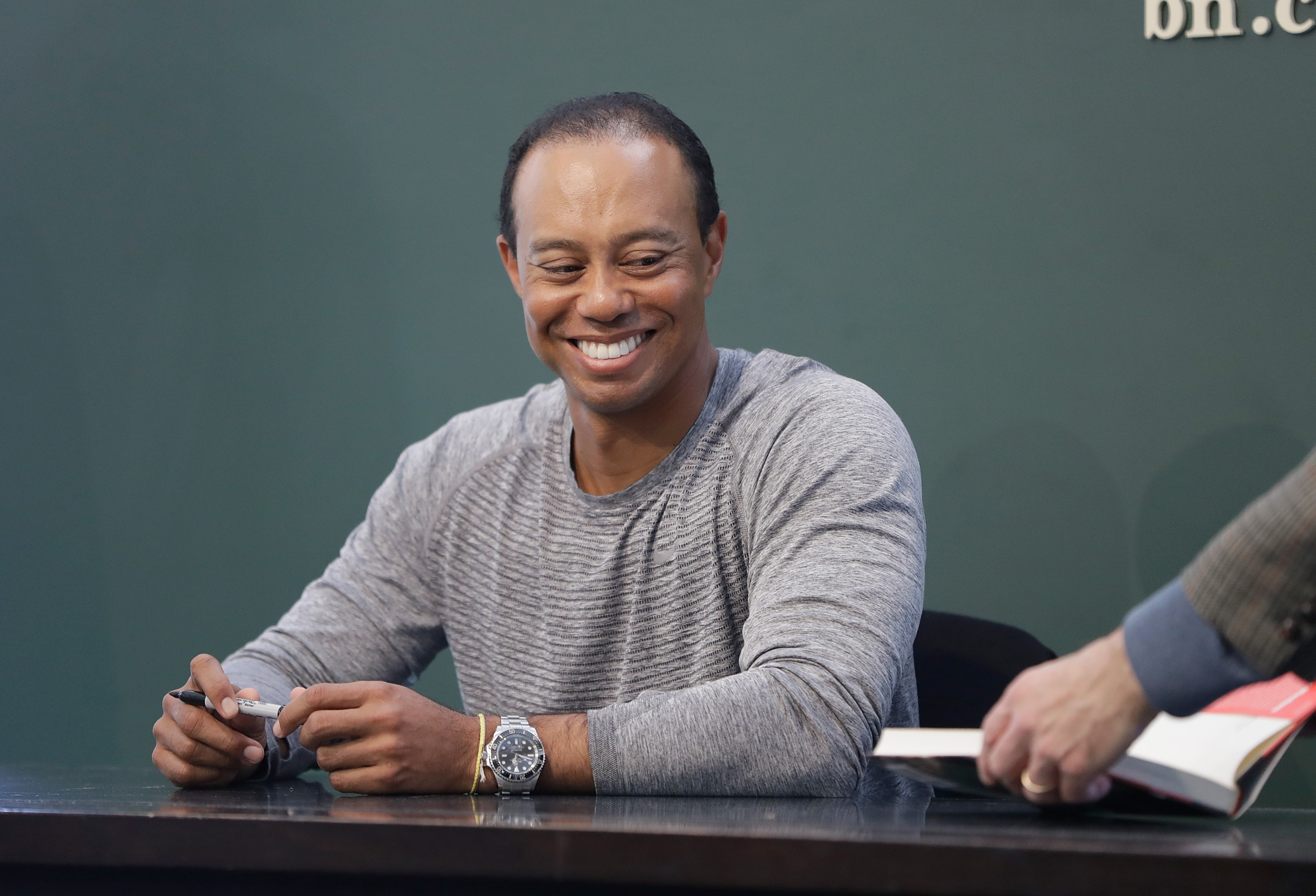 Tiger Woods Signs Copies Of His New Book 'The 1997 Masters: My Story'