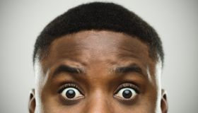 Close-up portrait of african man shocked