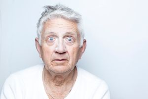 Senior with flour on the face