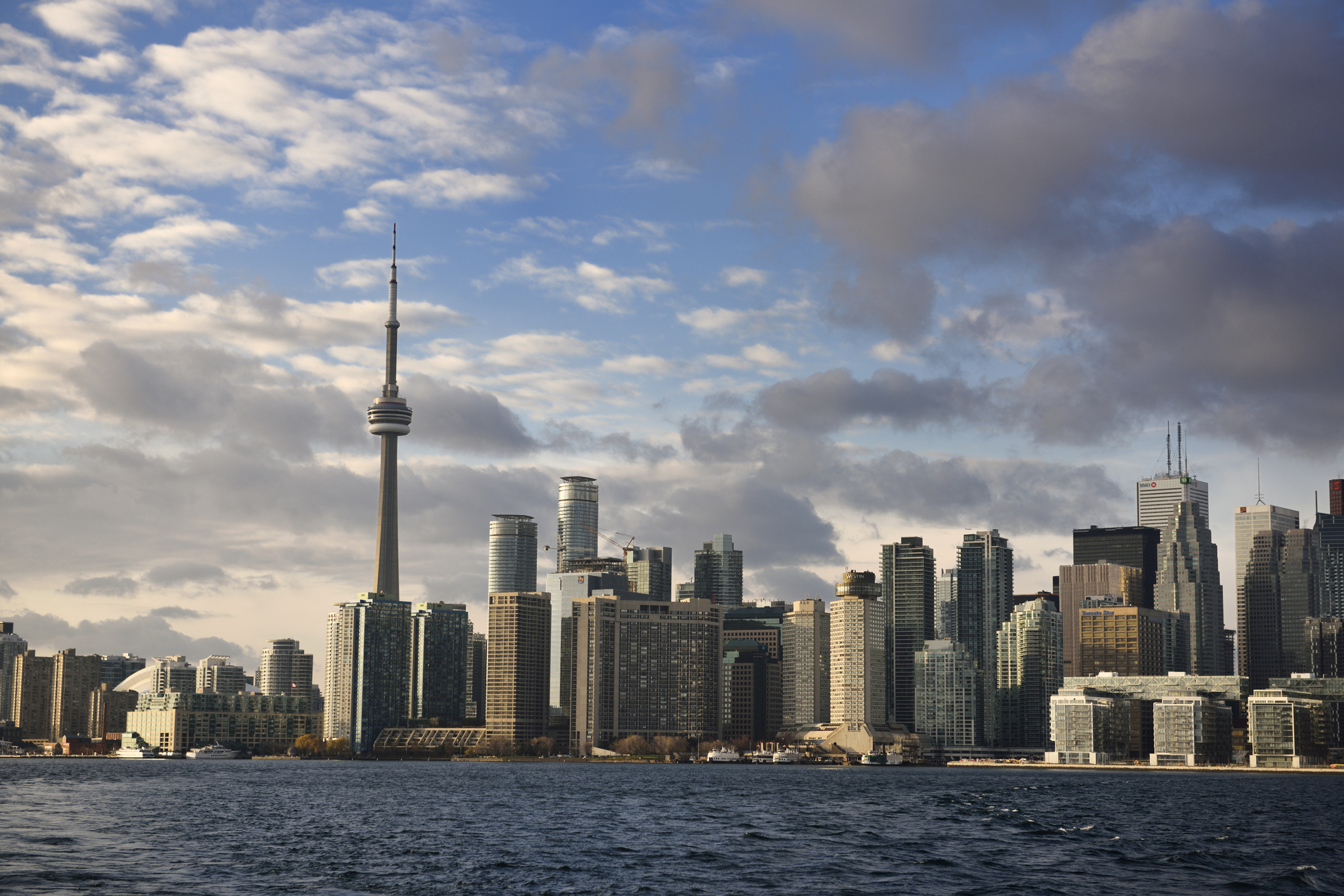 Evening sunlight on Toronto skyline high rise towers from Ferry in harbor