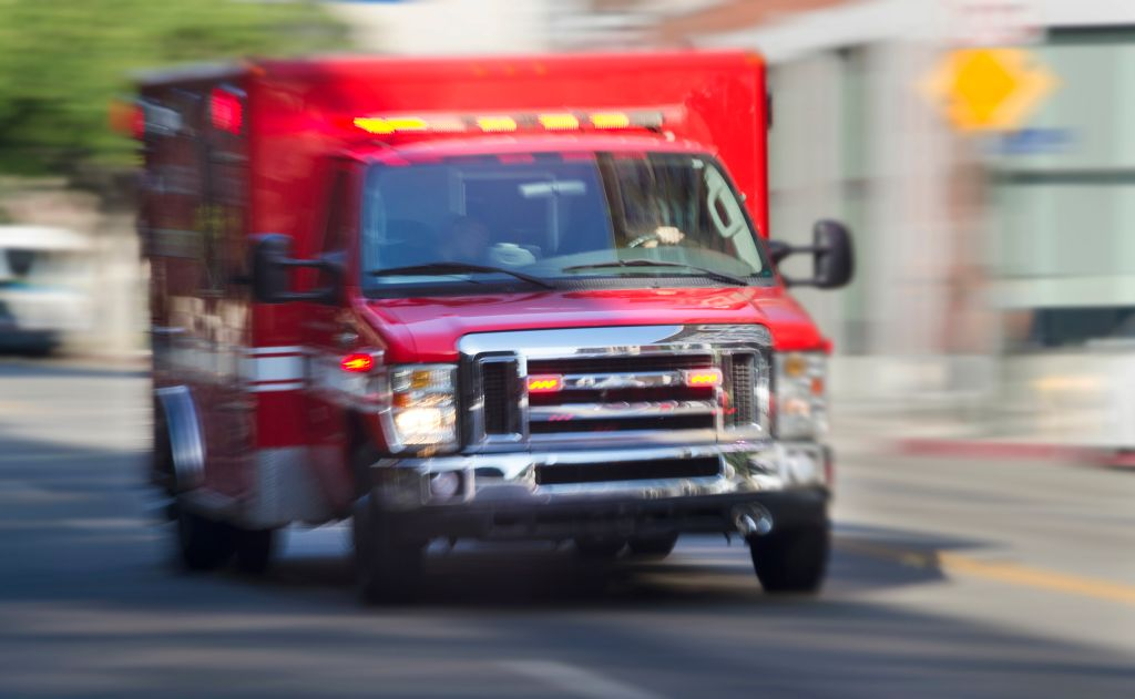 Ambulance hurrying through city streets