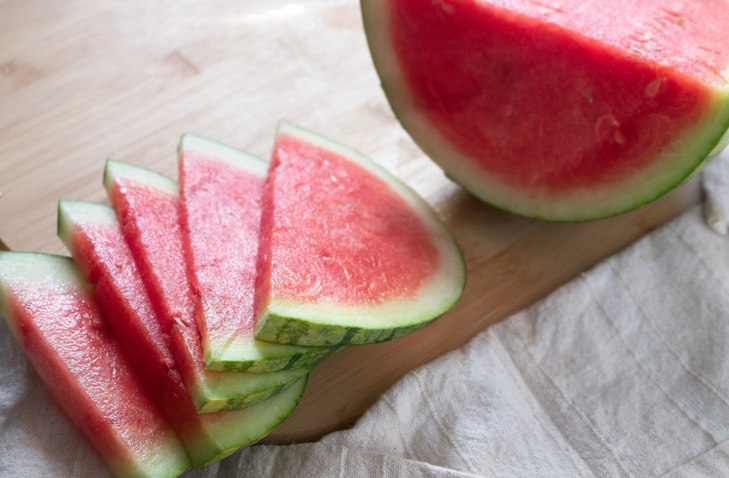 High Angle View Of Watermelon Slices On Cutting Board