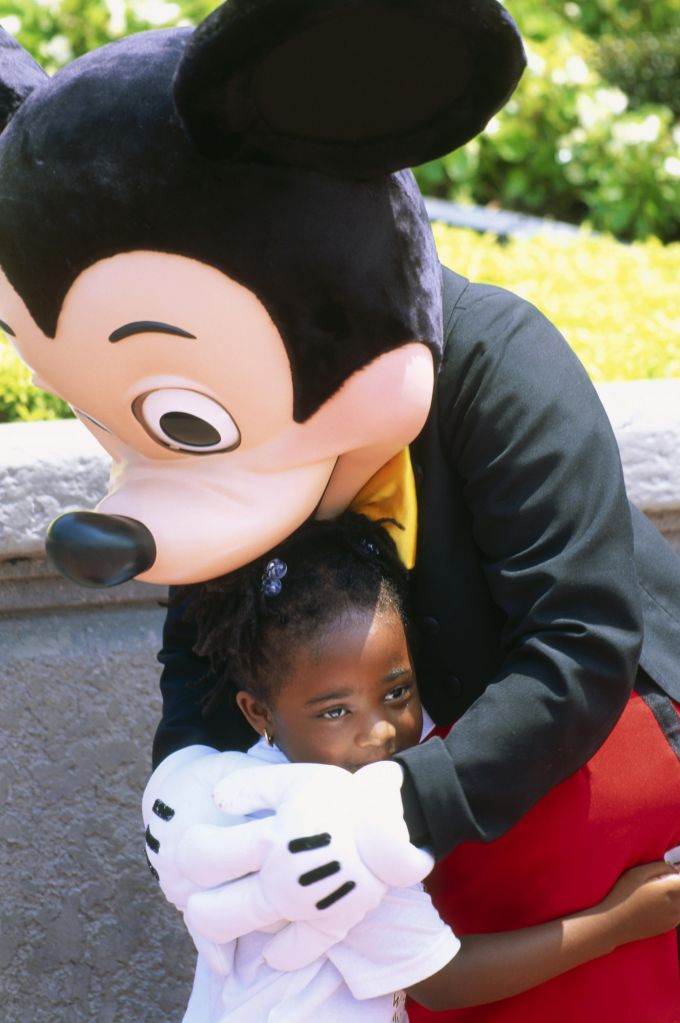 Mickey Mouse mit Kind, Disneyworld, Orlando, Florida, USA