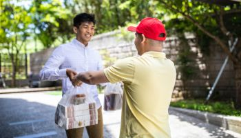 Kind Delivery man delivering Chinese take away food